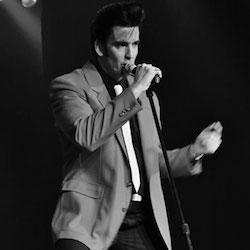 Rob Ely as Elvis image